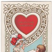 Boy Kneeling to Give Girl a Valentine Valentine Vintage Postcard