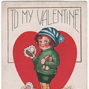 Boy Holding Valentine with More at His Feet Valentine Vintage Postcard