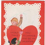 Boy Holding Suspended Red Heart over a Girl Valentine Vintage Postcard