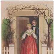 Signed Clapsaddle Couple Standing in Doorway Vintage Christmas Postcard