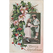 Girl with Boy Standing on a Swing Pink Flowers Holly Vintage Christmas Postcard
