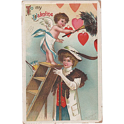 SOLD Signed Clapsaddle Cupid on a Ladder Dusting Hearts Vintage Valentine Postcard - Red Tag S