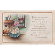 Whitney Woman Hanging Holly Wreath in Window Vintage Christmas Postcard