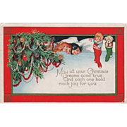 Two Children Asleep Hanging Stockings Full of Toys Vintage Christmas Postcard