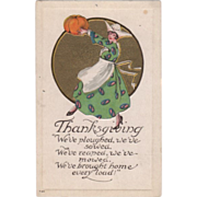 Young Woman in a Hat and Apron with Pumpkin Vintage Thanksgiving Postcard
