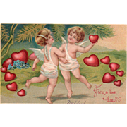 Two Cupids Dancing in a Ring of Red Hearts Vintage Valentine Postcard
