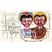 Man and Woman With Heart Shaped Faces Sharing a Drink Vintage Valentine Postcard