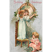 SOLD Two Little Girls Decorating with Holly Vintage Birthday Postcard