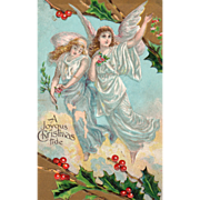 Two Angels in White Flying over the Earth Holly Vintage Christmas Postcard