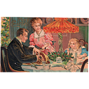 Family at Dinner Table Christmas Tree Holly Vintage Christmas Postcard