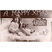Girl Brushing Doll's Hair while Seated on a Bed Vintage Christmas Postcard