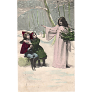 Lady in Pink with Untrimmed Tree Helping Children Vintage Christmas Postcard
