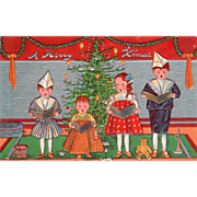 SOLD Children Caroling in Front of a Christmas Tree Vintage Christmas Postcard - Red Tag Sale