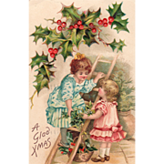 Two Little Girls with a Ladder Mistletoe and Holly Vintage Christmas Postcard