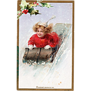 Girl in a Red Coat and White Hat Riding a Toboggan Vintage Christmas Postcard
