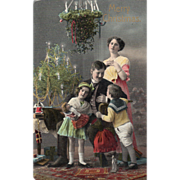 SOLD Family in Room Decorated for Christmas Tree on Table Vintage Christmas Postcard