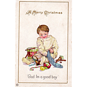 Little Boy in White Emptying His Christmas Stocking Vintage Christmas Postcard