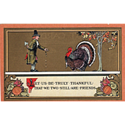 Pilgrim Man with an Axe Trying to Feed Gobbler Vintage Thanksgiving Postcard