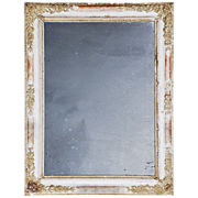 SOLD French Mirror in floral frame with traces of gilding.