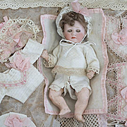 Antique German Tiny Character Heubach baby doll in all original presentation box by SFBJ  for a luxury Parisian store, excellent unplayed with condition!