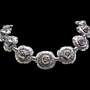 Silvertone Metal Rose Necklace - 14 Roses
