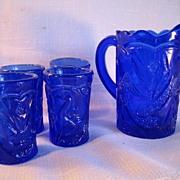 Cobalt Blue Pressed Glass Peacock Bird Design Miniature Pitcher with Four Glasses