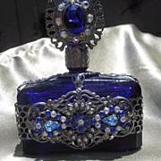 Cobalt Blue Perfume Bottle with Filigree Design