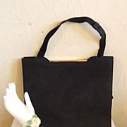 Sophisticated Black Suede Purse with Gold Tone Closure