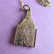 Unusual Opening Engraved 9K Gold Pendant