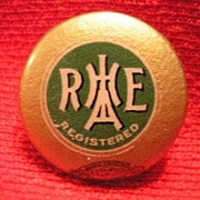 R H A E H A R E I H R E A  tin lithograph lapel pin back button.
