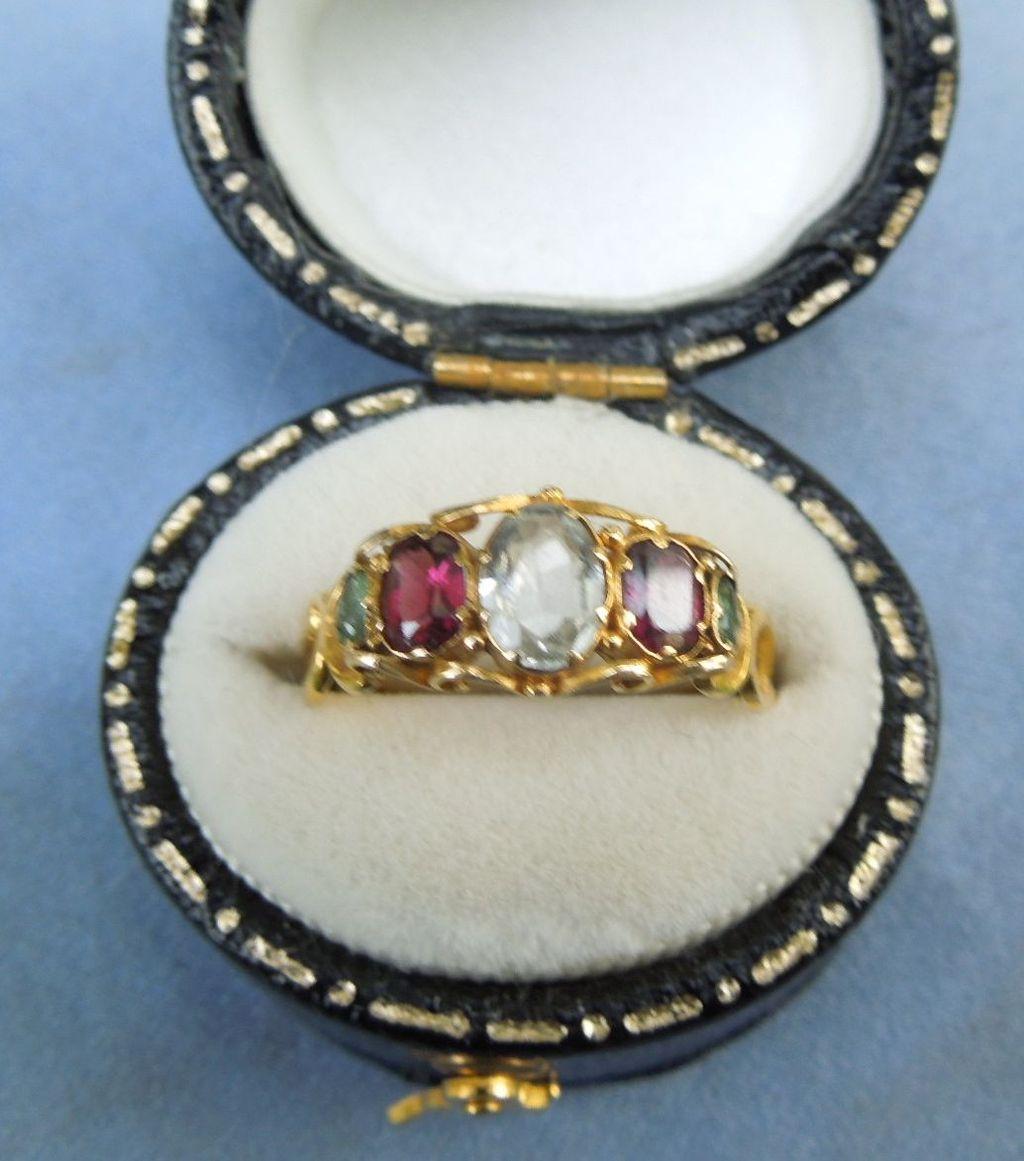 Aquamarine and garnet ring