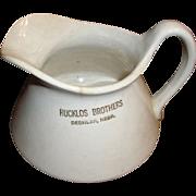 "Rucklos Brothers Deshler Nebraska cream, milk, water pitcher. 5"" semi-porcelain"