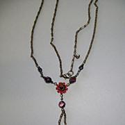 Older Necklace and Earrings Garnet like stones.