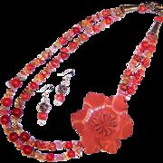 FUN! Leather Flower Power Tastefully Orange Necklace & Earrings Set
