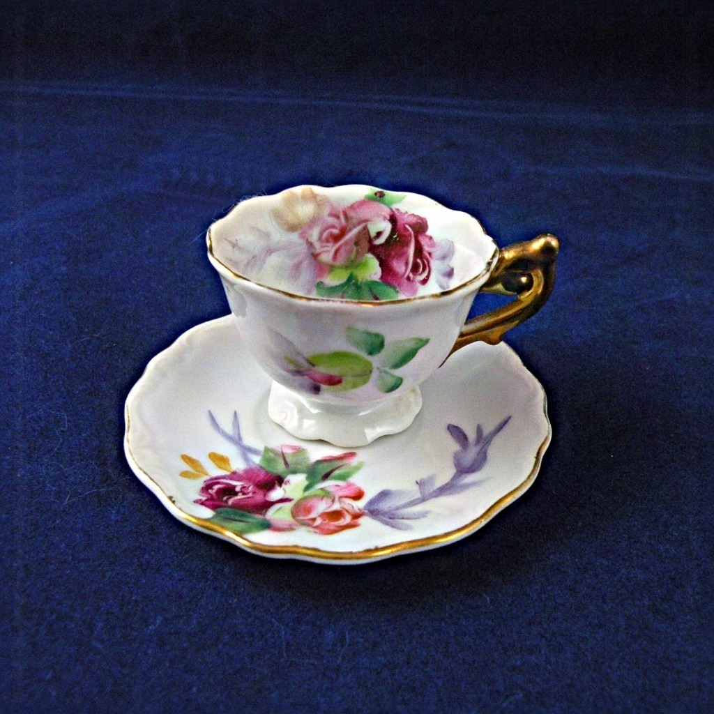 Miniature Porcelain Teacup and Saucer with Roses