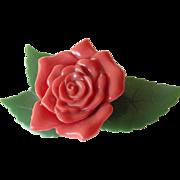 Early plastics- large Rose pin