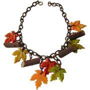 """Celluloid """" leaves and logs"""" necklace"""