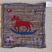 Knitted Rocking Horse Pillow Front