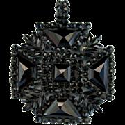 A Victorian Black Glass Maltese Cross. Circa 1875.
