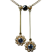 An Edwardian 15ct Gold, Sapphire and Pearl Neglige Pendant. Circa 1905.