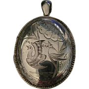 A Victorian Sterling Silver Locket. Circa 1885.