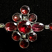 A Georgian 9ct Gold, Garnet, Paste & Seed Pearl Fichu Brooch, Circa 1820.