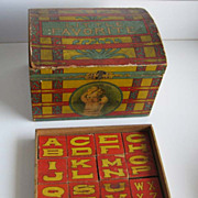Antique Bliss dome paper litho trunk with original blocks in an inside tray