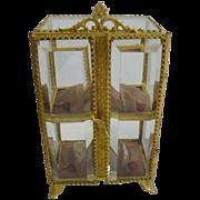 Antique French ormolu miniature display beveled glass vitrine on decorative legs
