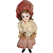 Antique French girl mignonette in original clothes