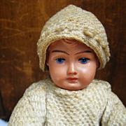 Vintage German Christmas sledder celluloid head cotton clothing