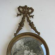 Antique gilt metal decorative ribbon picture frame