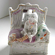 Antique Conta Boehme porcelain Fairing child pulling on sock figurine