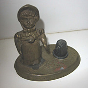 Antique figural Kate Greenaway brass sewing thimble holder