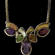14 Karat Modernist Necklace Enhanced with Amethyst, Garnet, Citrine and Peridot Stones